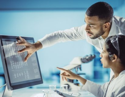 woman and man at a computer in a medical environment