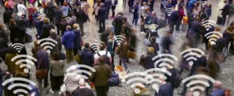 People standing about some using their phones with connection symbols composited in.